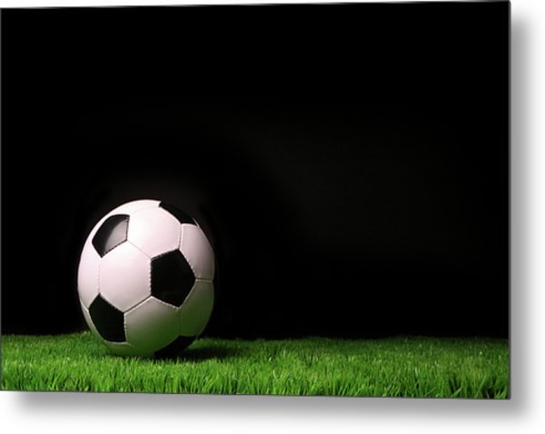 Soccer Ball On Grass Against Black Metal Print