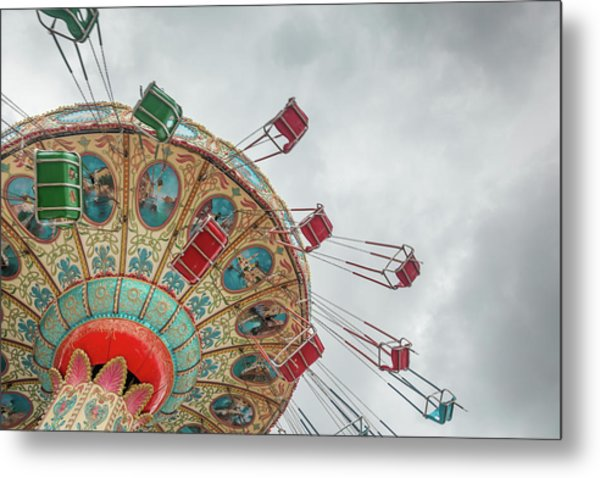 Swings In Motion With Stormy Sky Metal Print by Erin Cadigan