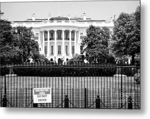 security fence and restricted area signs at the south facade of the white house Washington DC USA Metal Print