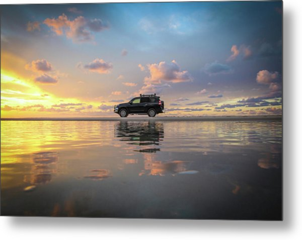 4wd Vehicle And Stunning Sunset Reflections On Beach Metal Print