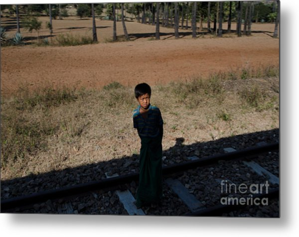 A Boy In Burma Looks Towards A Train From The Shadows Metal Print