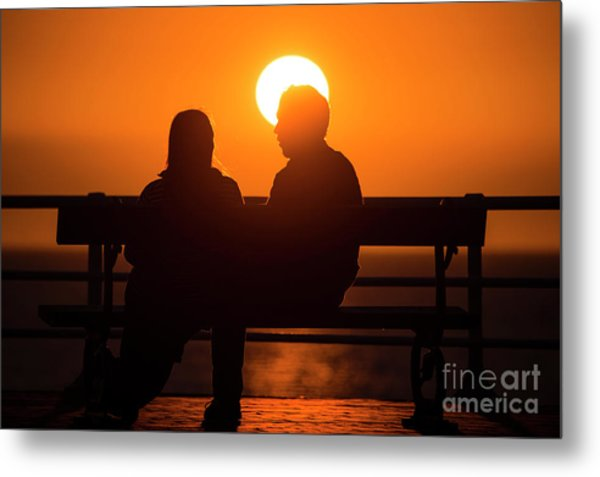 A Couple Sitting At Sunset Metal Print