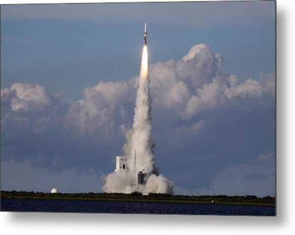 A Delta Iv Rocket Soars Into The Sky Metal Print