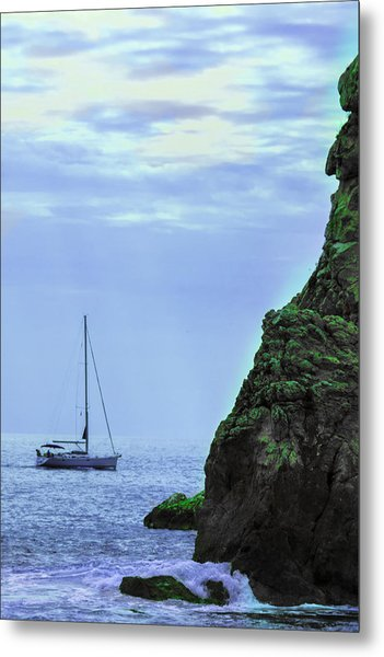 A Lone Sailboat Floats On A Calm Sea Metal Print