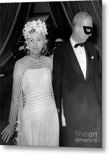 A Masquerade Ball For Actress, Joan Fontaine, And Her Guest. 1966 Metal Print by William Jacobellis