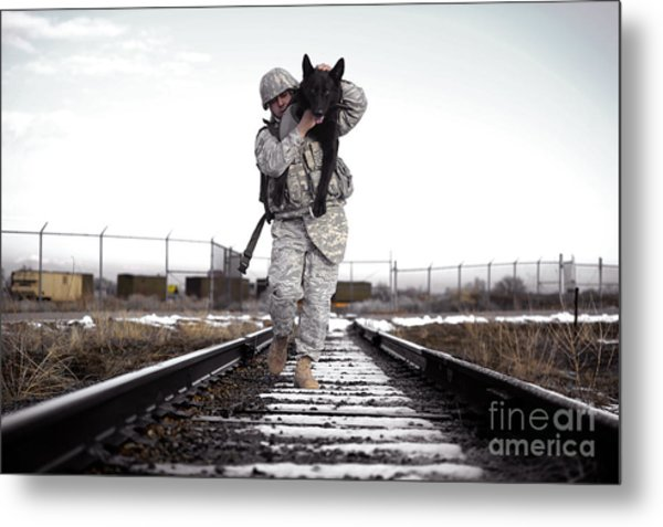 A Military Dog Handler Uses An Metal Print