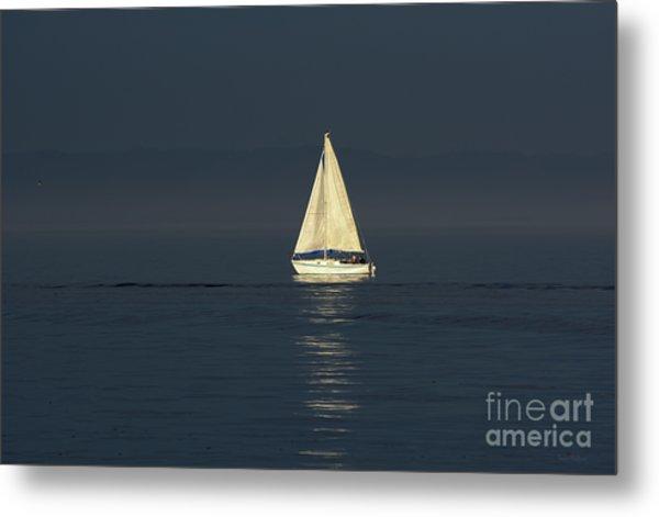 A Sailboat Capturing Light Metal Print