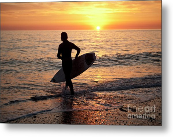 A Young Man Surfing At Sunset Off Aberystwyth Beach, Wales Uk Metal Print