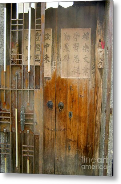 Abandoned Wooden Door With Gate Metal Print by Kathy Daxon