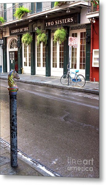 Across The Street In The French Quarter Metal Print by John Rizzuto