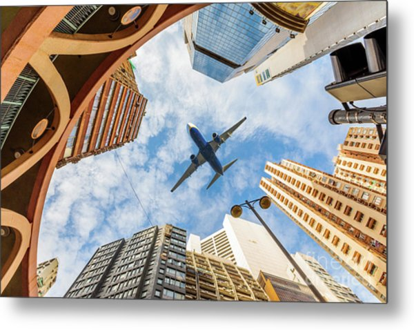 Airplane Above City Metal Print