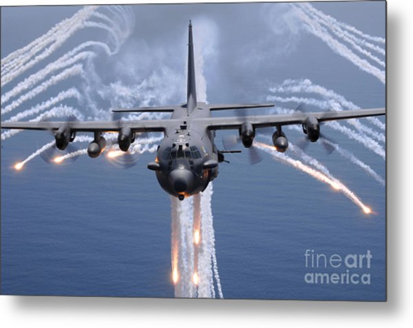 An Ac-130h Gunship Aircraft Jettisons Metal Print