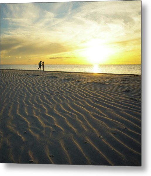 Beach Silhouettes And Sand Ripples At Sunset Metal Print