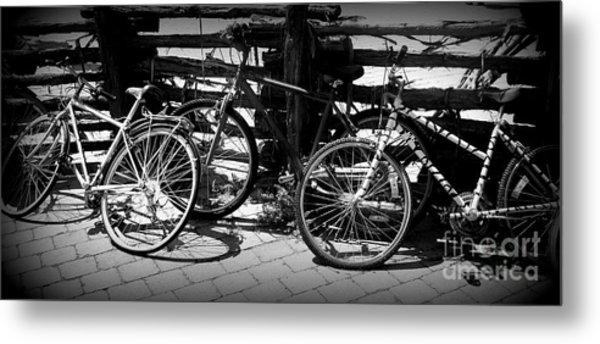 Black And White Leaning Bikes Metal Print by Emily Kelley