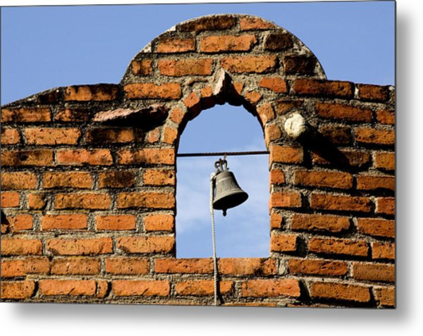 Brick Wall And Bell Metal Print by Xavier Cardell