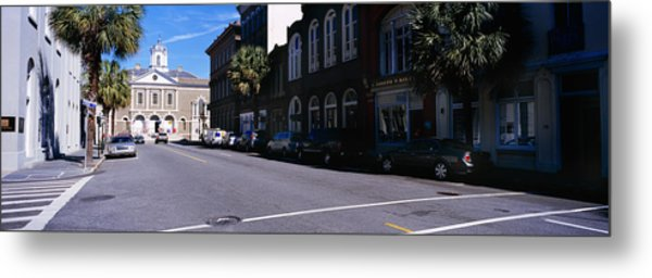 Buildings On Both Sides Of A Road Metal Print