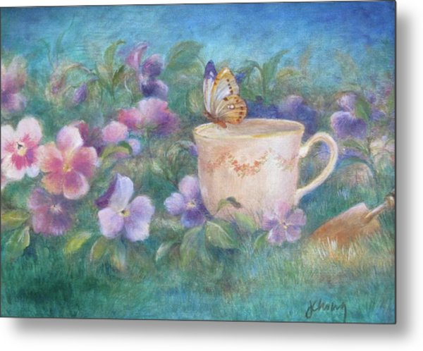 Butterfly On Teacup Metal Print