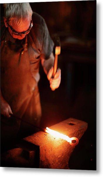 Close-up Of  Blacksmith Forging Hot Iron Metal Print