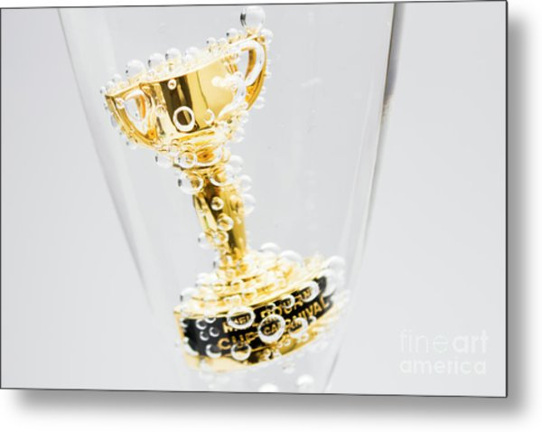 Closeup Of Small Trophy In Champagne Flute. Gold Colored Award I Metal Print