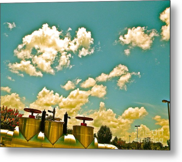 Clouds Over Oil Field Equipent Metal Print by Chuck Taylor