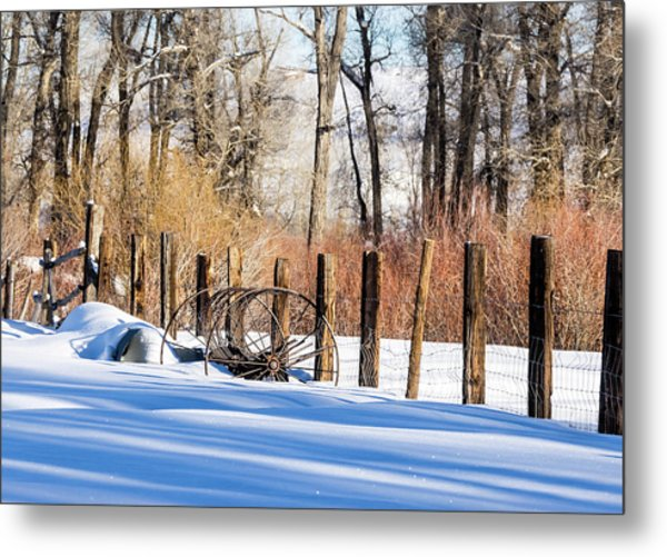 Metal Print featuring the photograph Colorado Winter Snow Scene With Old Farming Rake And Rustic Fence by Nadja Rider