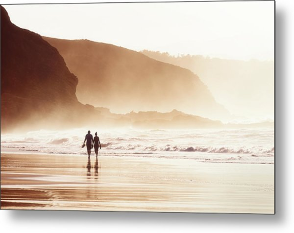 Couple Walking On Beach With Fog Metal Print