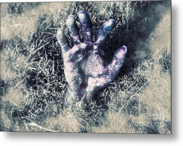 Decaying Zombie Hand Emerging From Ground Metal Print