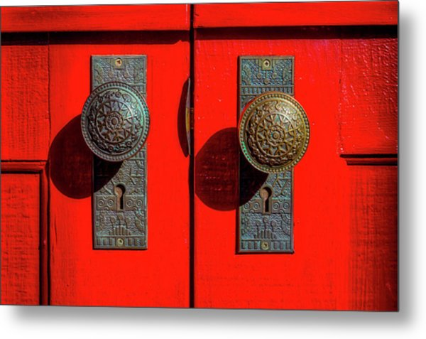 Doorknobs On Red Door Metal Print