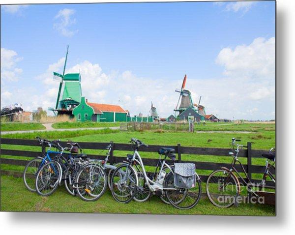 dutch windmills with bikes in Zaanse Schans Metal Print