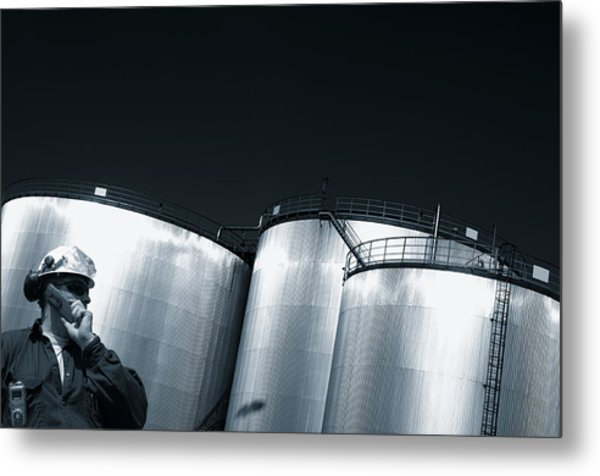 Engineer And Oil Towers At Sunset Metal Print