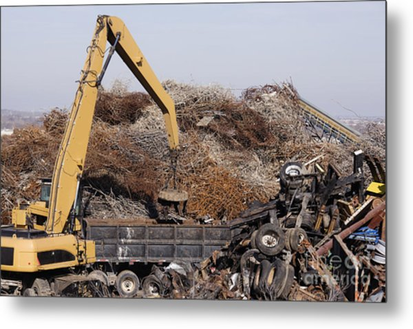 Excavator Moving Scrap Metal With Electro Magnet Metal Print by Jeremy Woodhouse