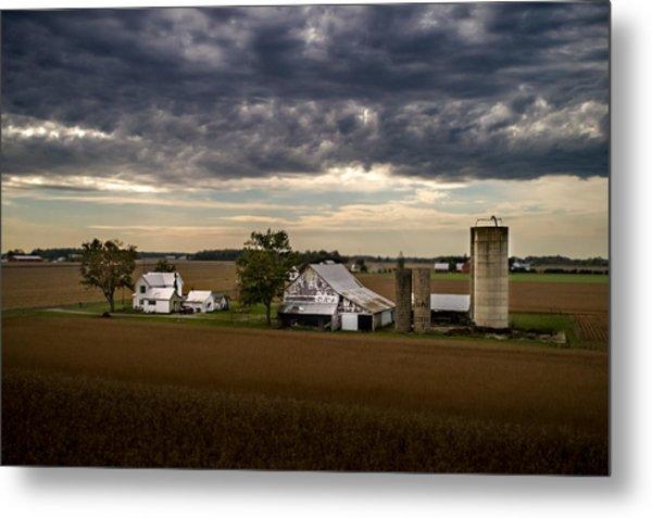 Farmstead Under Clouds Metal Print