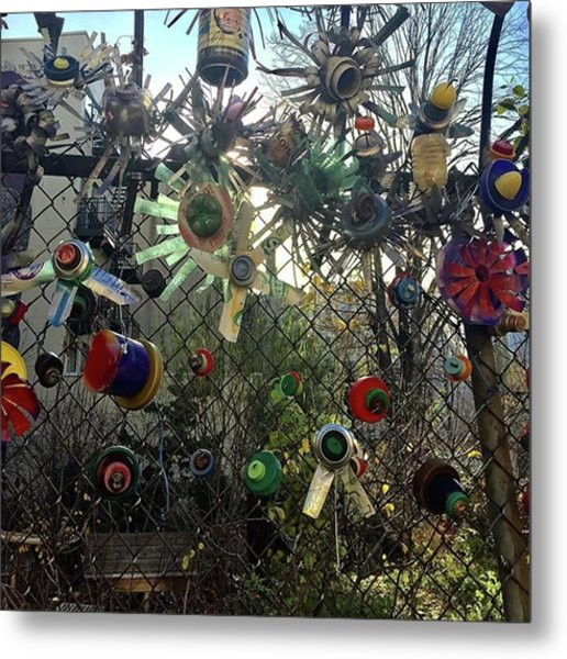 Fence Decorations Surrounding A Metal Print by Gina Callaghan