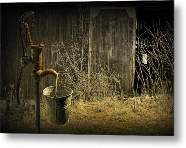 Fetching Water From The Old Pump Metal Print