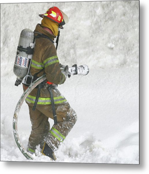Firefighter In The Snow Metal Print by Jack Dagley