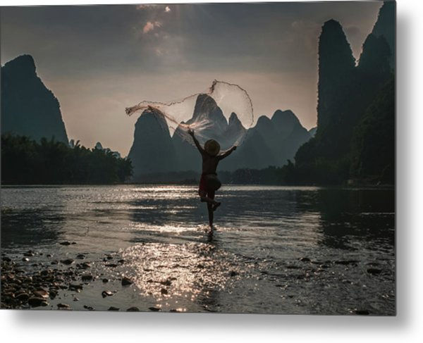 Fisherman Casting A Net. Metal Print
