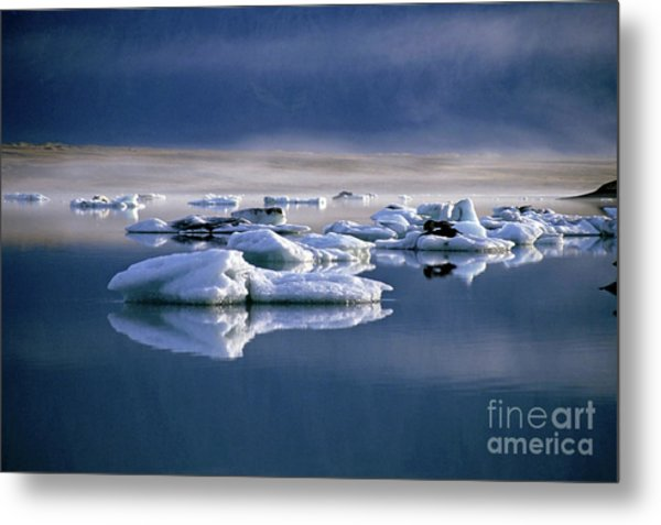 Floating Icebergs Reflected In The Quiet Waters Of Jokulsarlon Metal Print by Sami Sarkis