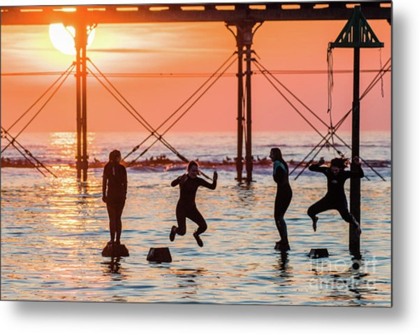 Four Girls Jumping Into The Sea At Sunset Metal Print