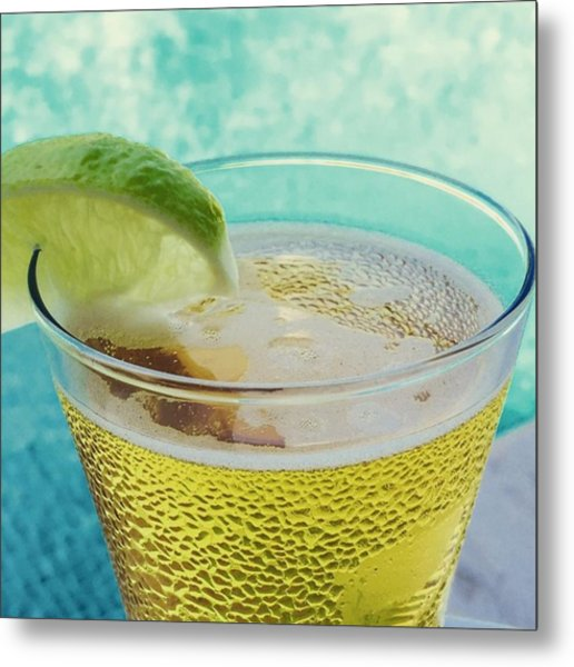 Glass Of Beber With Lime By A Pool Metal Print
