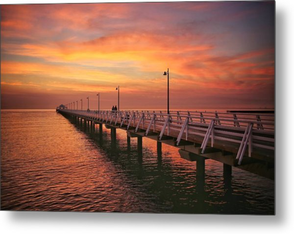 Golden Red Skies Over The Pier Metal Print