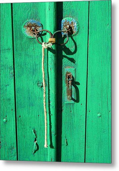 Green Door With Spectacles Metal Print by Donald Buchanan