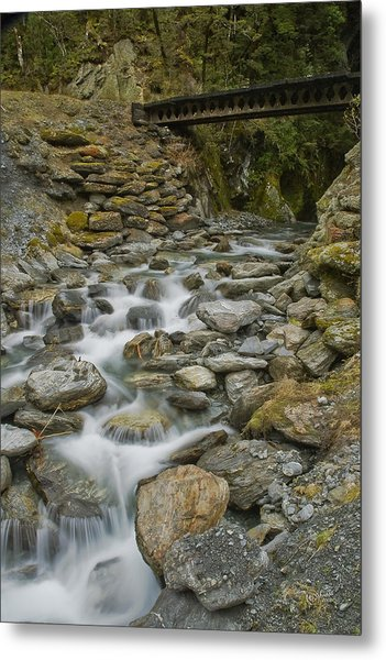 Haast Waterfall Metal Print by Andrea Cadwallader