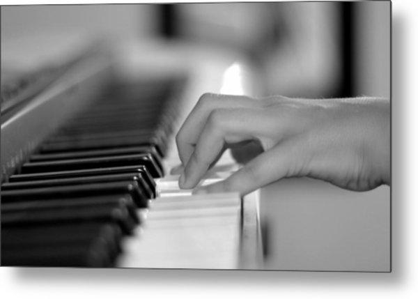 Hand On Piano Keyboard Metal Print