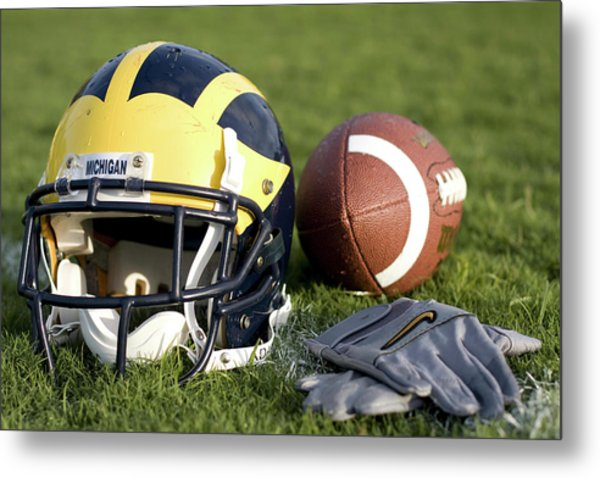 Helmet On The Field With Football And Gloves Metal Print