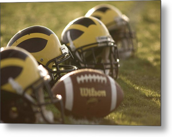 Metal Print featuring the photograph Helmets And A Football On The Field At Dawn by Michigan Helmet