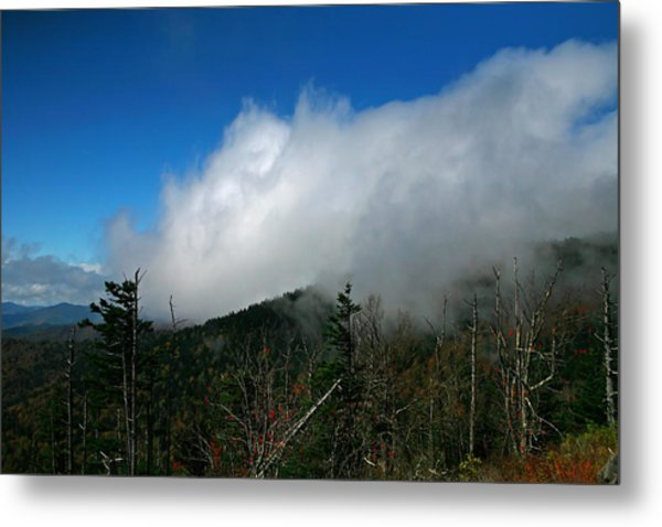 In The Clouds Metal Print by James Jones