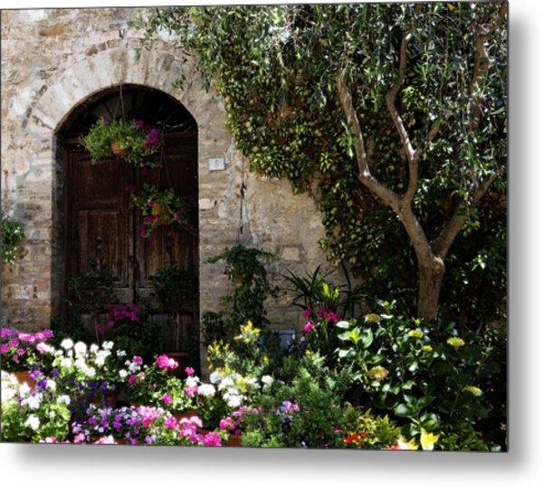 Italian Front Door Adorned With Flowers Metal Print