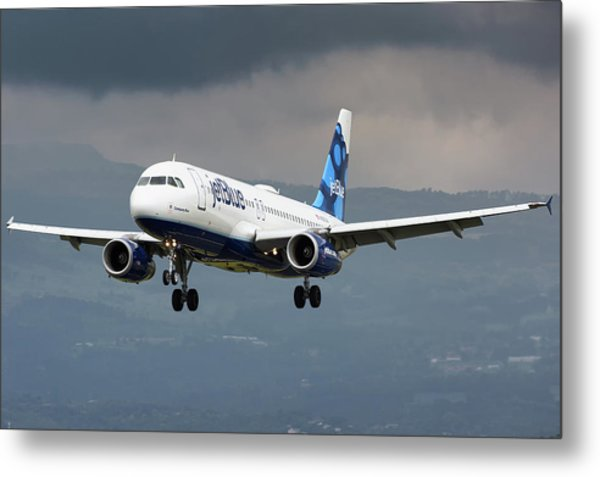 jetBlue A320 landing with mountain Metal Print