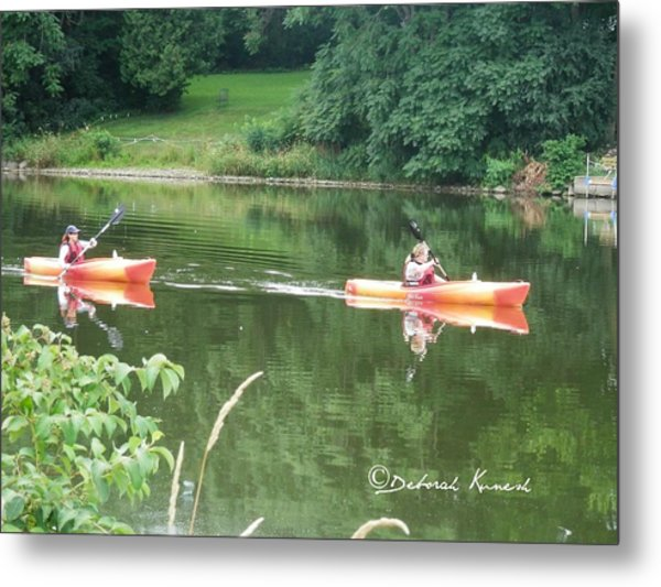 Kayaks On The River Metal Print
