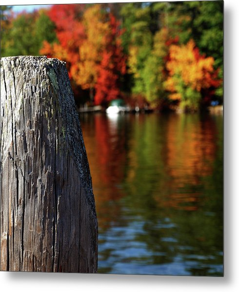 Lake Winnepesaukee Dock With Foliage In The Distance Metal Print